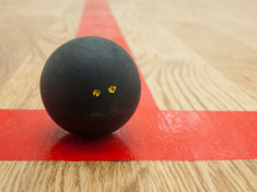 stock-photo-27950948-squash-ball-on-t-line
